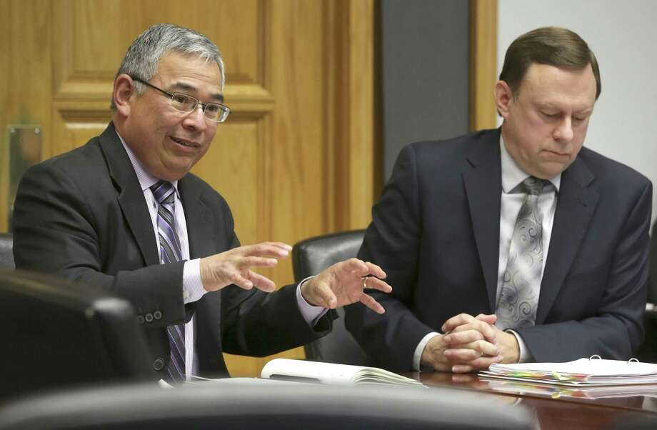 City Attorney Andrew Segovia, left, and auditor Kevin W. Barthold make a presentation to City Council's Governance Committee, in January about tax-dollar oversight. The committee was looking at the issue of tax-dollar oversight after the alleged embezzlement at Centro. Photo: William Luther /San Antonio Express-News / © 2018 San Antonio Express-News