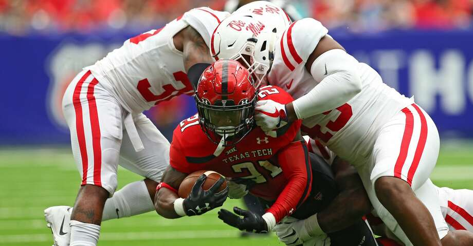 Texas Tech Red Raiders running back Da'Leon Ward (21) runs against the Mississippi Rebels defense during the first half of an NCAA game at NRG Stadium Saturday, Sept. 1, 2018, in Houston. Photo: Godofredo A. Vasquez/Staff Photographer