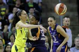 Former UConn player Sue Bird, left, now a member of the WNBA's Seattle Storm, was invited to USA Basketball Women's National Team's upcoming training camp.