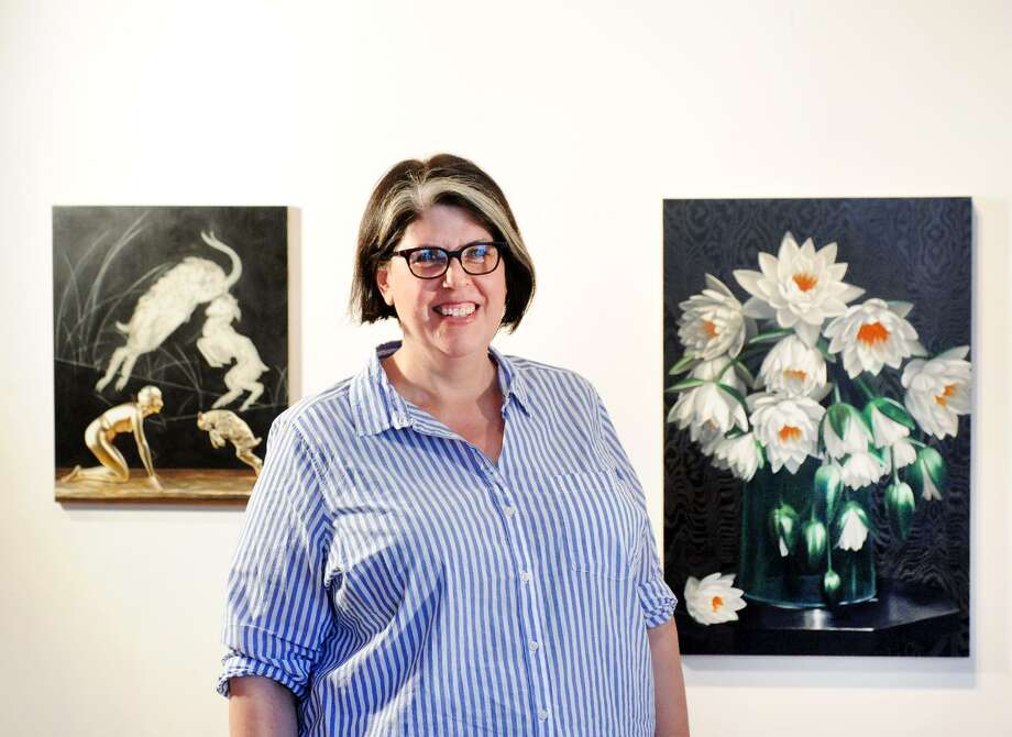 "Rebecca Smith Ford of Greenwich, a painter, with her work in her studio in Port Chester, N.Y., Wednesday, August 29, 2018. Smith Ford will be exhibiting her work on September 6th as part of the show ""Looking Forward, Looking Back,"" celebrating the Flinn Gallery's 90th anniversary season. The Flinn Gallery is located on the second floor of Greenwich Library. Photo: Bob Luckey Jr. / Hearst Connecticut Media / Greenwich Time"