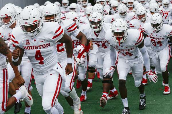Houston players run out of the tunnel for an NCAA football game against Rice at Rice Stadium on Saturday, Sept. 1, 2018, in Houston.