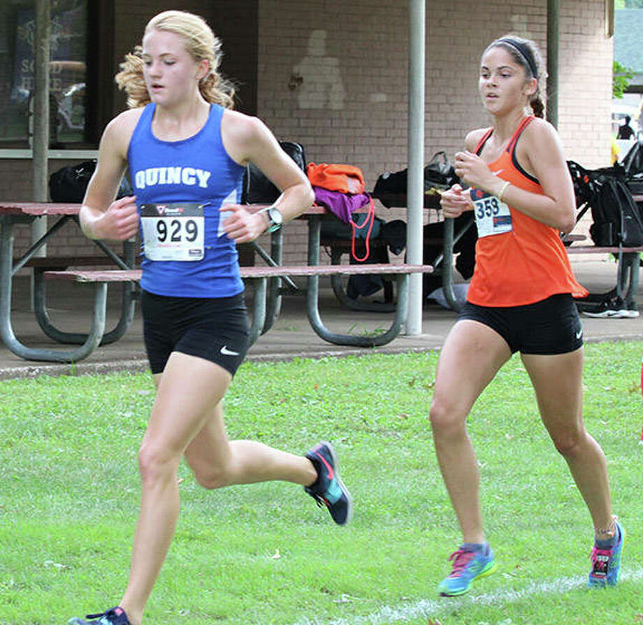 Edwardsville's Abby Korak (right) shadows race leader Quincy's Lydia Kurfman midway through the Granite City Invitational girls cross country meet Saturday morning at Wilson Park. Korak would overtake Kurfman to win the race by more than 12 seconds. Photo: Greg Shashack / The Telegraph