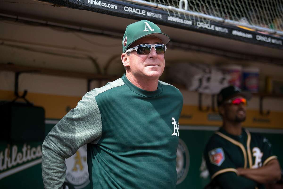 Oakland Athletics manager Bob Melvin watches his team take on the San Francisco Giants in a Major League Baseball game, Sunday, March 25, 2018 in Oakland, Calif.