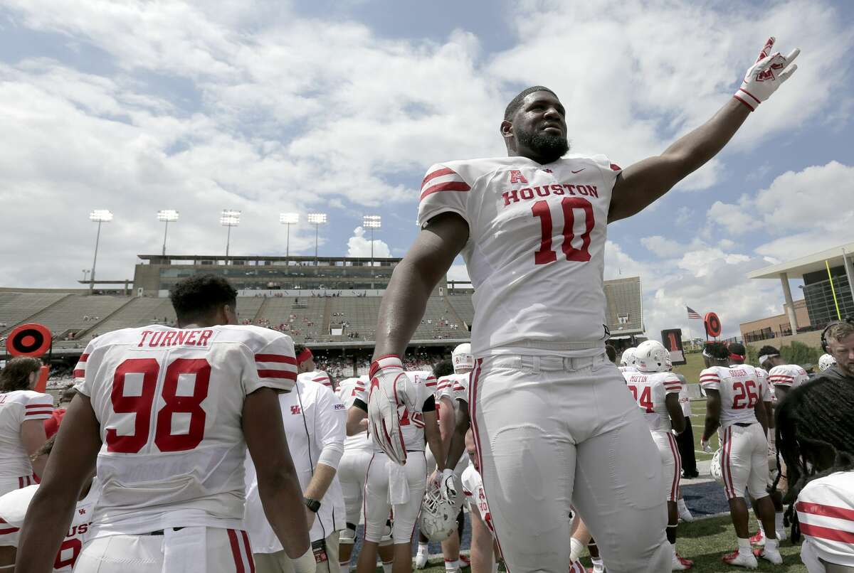 Houston Cougars defensive tackle Ed Oliver (10) gets fans involved during the third quarter against the Rice Owls on Saturday, Sept. 1, 2018 in Houston. Houston Cougars won the game 45-27.