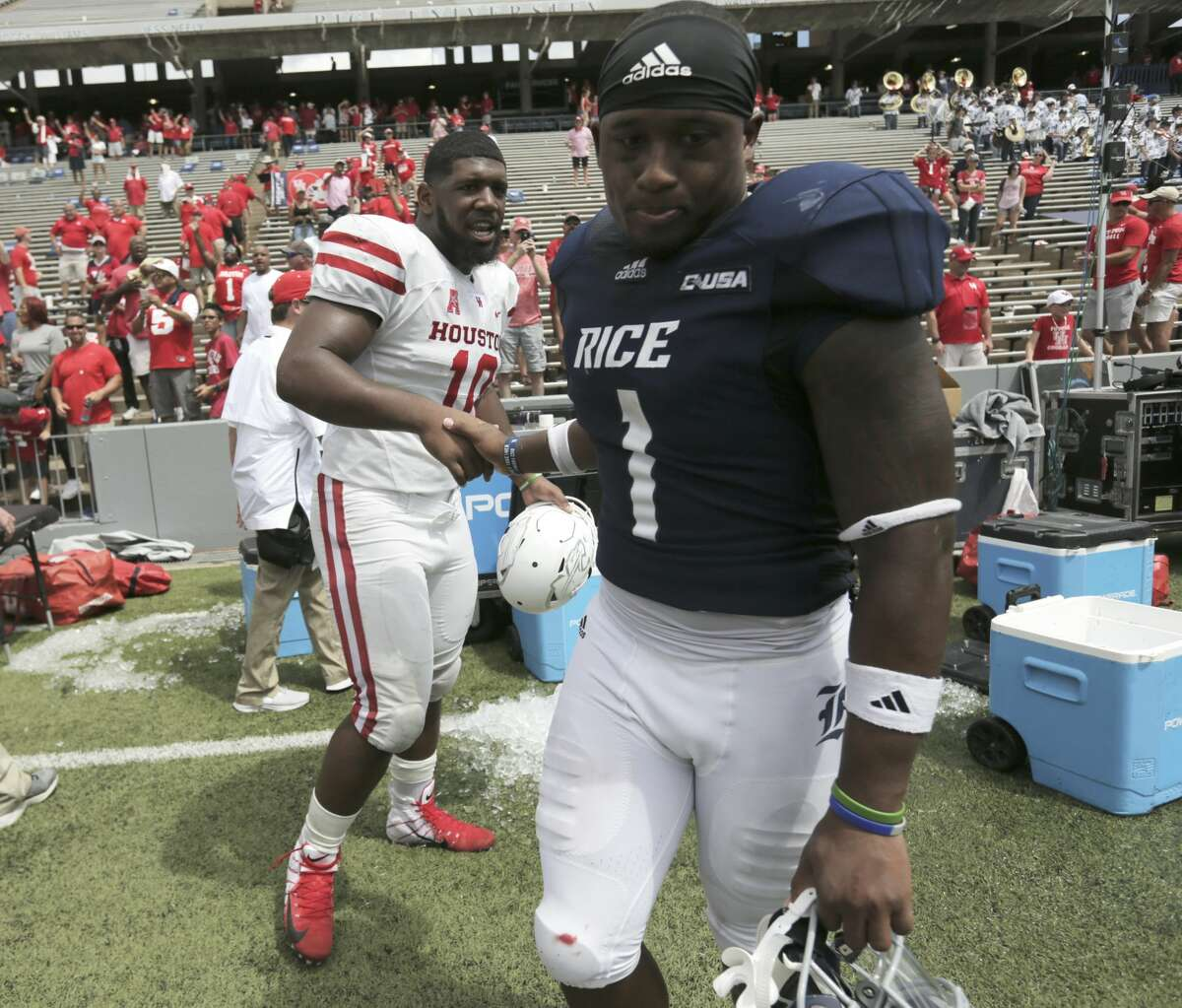 Houston Cougars defensive tackle Ed Oliver (10) shakes hands with Rice Owls running back Aston Walter (1) after Houston's 45-27 win over Rice on Saturday, Sept. 1, 2018 in Houston.