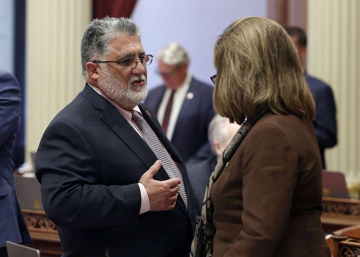 State Sen. Anthony Portantino, D-La Canada Northridge, talks with Republican Senate Leader Patricia Bates, of Laguna Niguel, during the Senate session, Tuesday, Aug. 28, 2018, in Sacramento, Calif. The Assembly approved Portantino's bill to raise the age to purchase a rifle or shotgun from 18 to 21. It now goes back to the Senate for a final vote. (AP Photo/Rich Pedroncelli)
