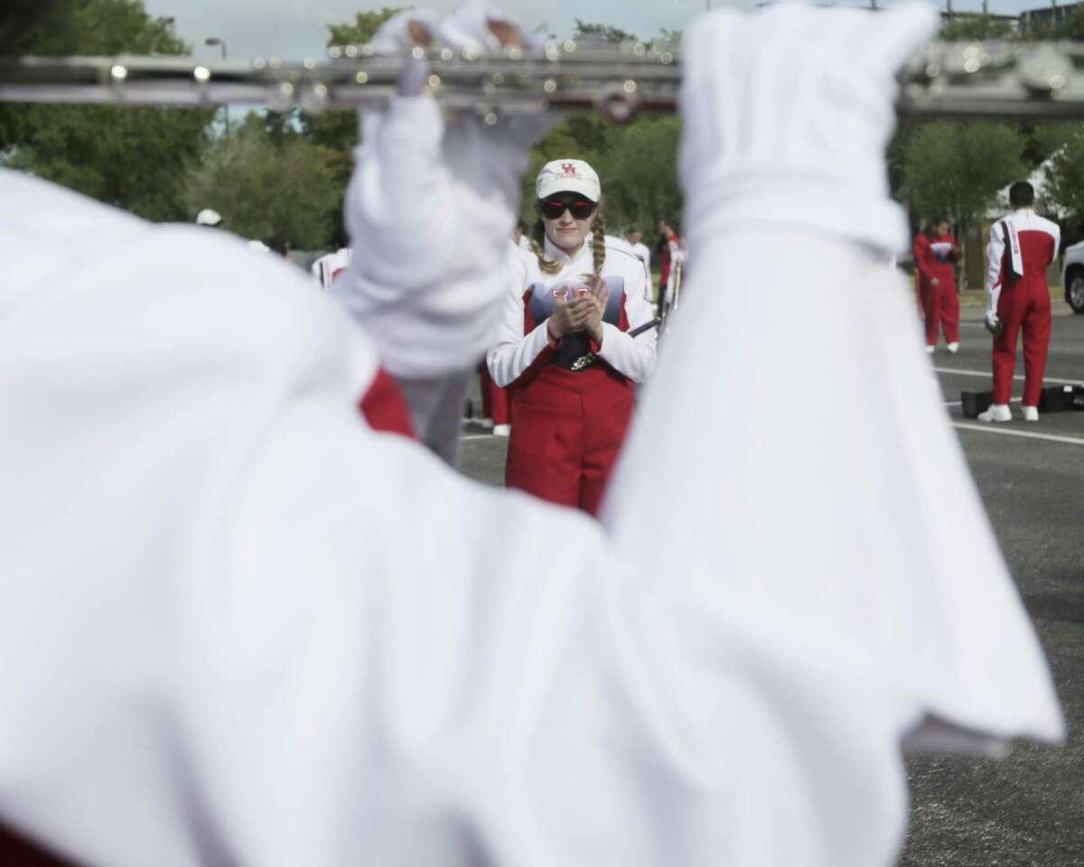 Band members of Houston Cougars marching band warm up before the football team takes on Rice University on Saturday, Sept. 1, 2018 in Houston.