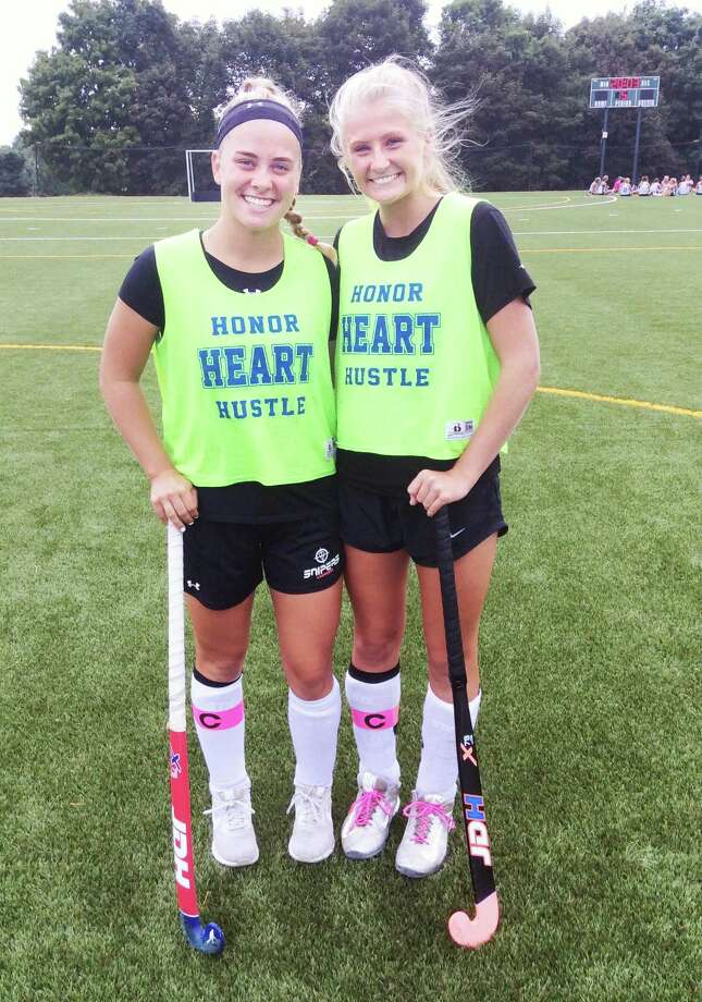 Ryan Smith, left, and Hilary Hoover are senior captains on the Sacred Heart Greenwich field hockey team. Photo: David Fierro / Hearst Connecticut Media / Greenwich Time