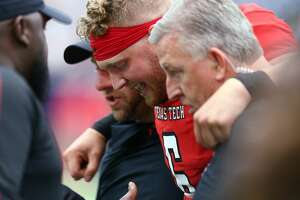 Texas Tech Red Raiders quarterback McLane Carter (6) is held off the field following an injury during the first quarter of an NCAA game against the Mississippi Rebels at NRG Stadium Saturday, Sept. 1, 2018, in Houston.