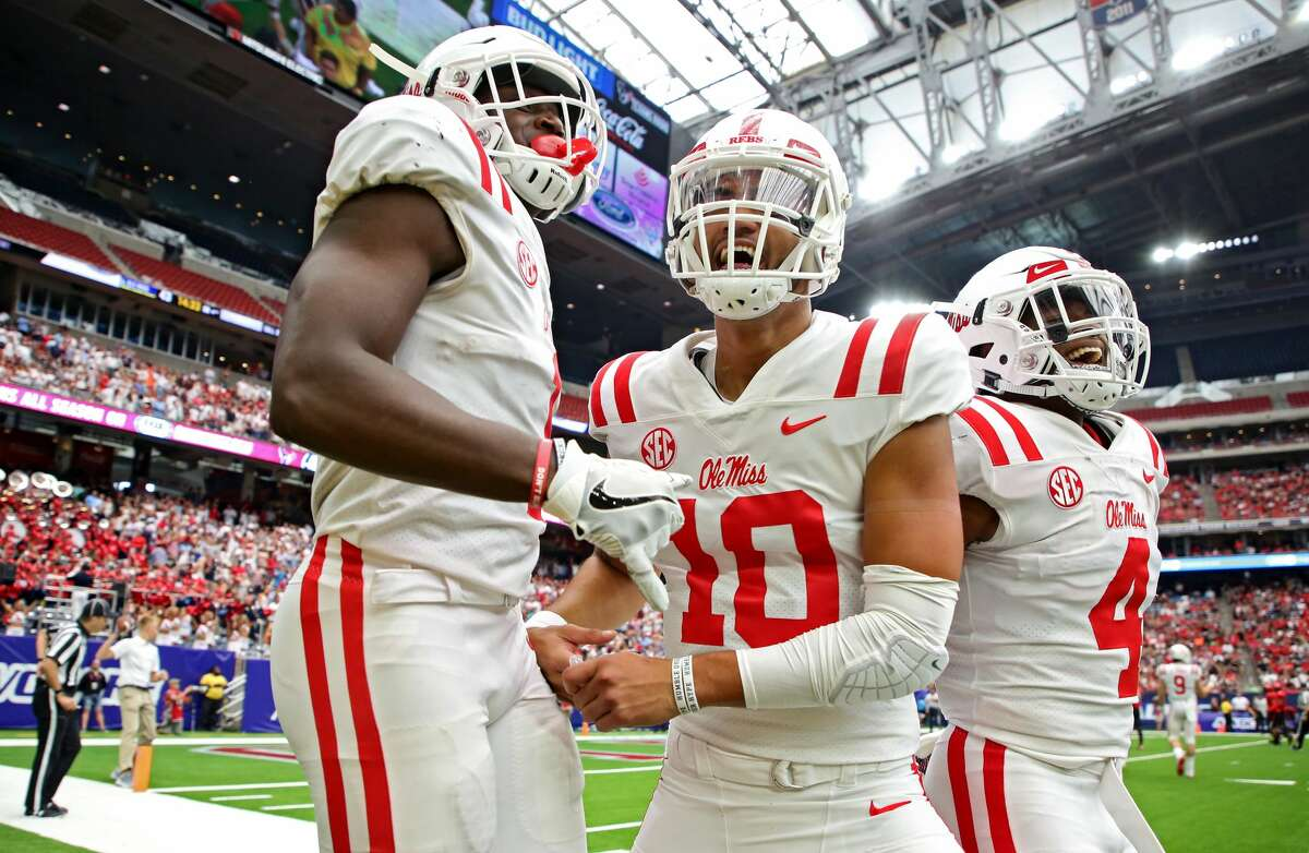 Mississippi Rebels wide receiver A.J. Brown (1) celebrates with quarterback Jordan Ta'amu (10) after their 34-yard touchdown connection against the Texas Tech Red Raiders during the fourth quarter of an NCAA game at NRG Stadium Saturday, Sept. 1, 2018, in Houston. The Rebels won 47-27.