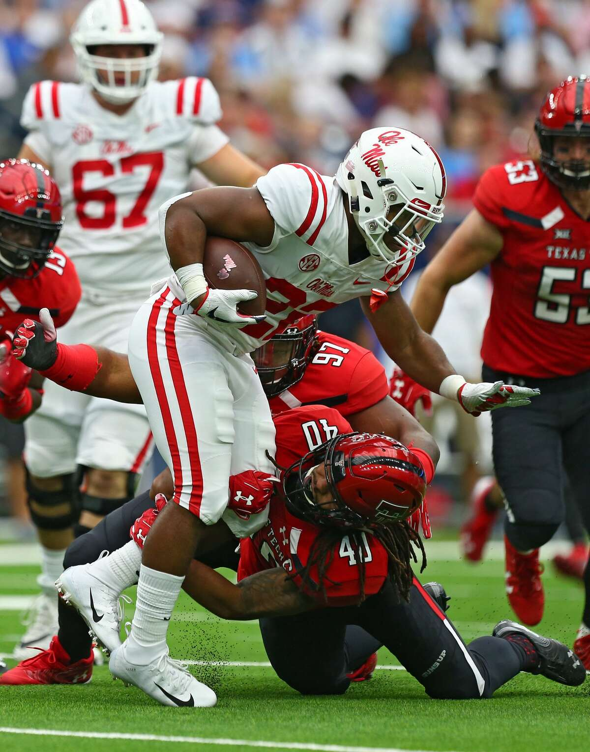 Mississippi Rebels running back Scottie Phillips (22) is tackled by Texas Tech Red Raiders linebacker Dakota Allen (40) during the first quarter of an NCAA game at NRG Stadium Saturday, Sept. 1, 2018, in Houston.