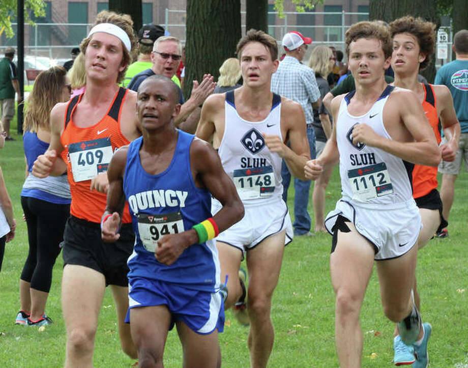 Quincy's Fiker Rosen (front) heads a lead pack including Edwardsville's Roland Prenzler (left) and SLUH's Lucas Rackers (middle) and Patrick Hetlage midway through the 3-mile cross country course at Wilson Park in Granite City on Saturday morning. Granite's Andrew O'Keefe (not pictured) was running left of that group and won the race. Photo: Greg Shashack / The Telegraph