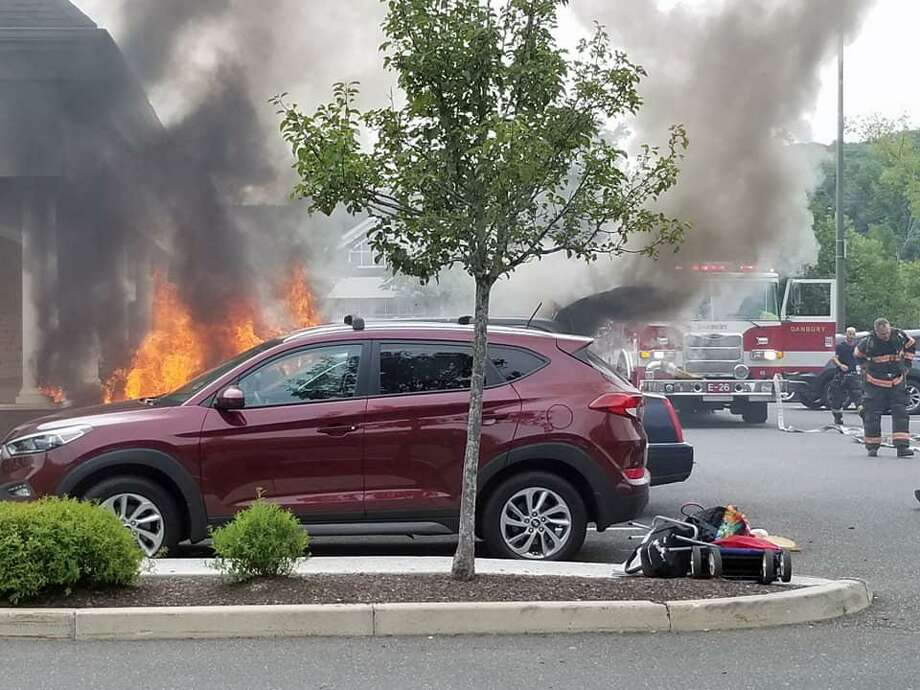 Around 1 p.m. on Sept. 1, 2018, fire units were sent to Trader Joe's on Mill Plain Road in Danbury, Conn., after calls about a vehicle fire. When firefighters got to the parking lot, they found a fully-involved van fire next to the side of the building, officials said. Photo: Contributed Photo / Danbury Fire Department / Contributed Photo / Connecticut Post Contributed