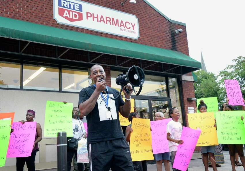 Willie White of AVillage leads local residents and community leaders in protesting the planned closure of the Rite Aid in the South End of Albany Friday August 31, 2018 in Albany, NY. Rite Aid was recently taken over by Walgreens, and the decision was made following the merger. (John Carl D'Annibale/Times Union)
