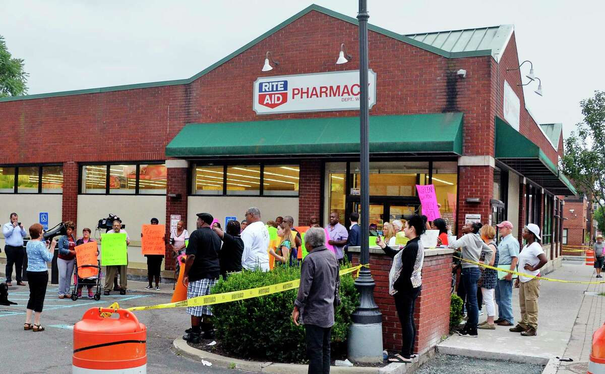 Mayor Kathy Sheehan, right with bullhorn,, joins local residents protesting the planned closure of the Rite Aid in the South End of Albany Friday August 31, 2018 in Albany, NY. Rite Aid was recently taken over by Walgreens, and the decision was made following the merger. (John Carl D'Annibale/Times Union)