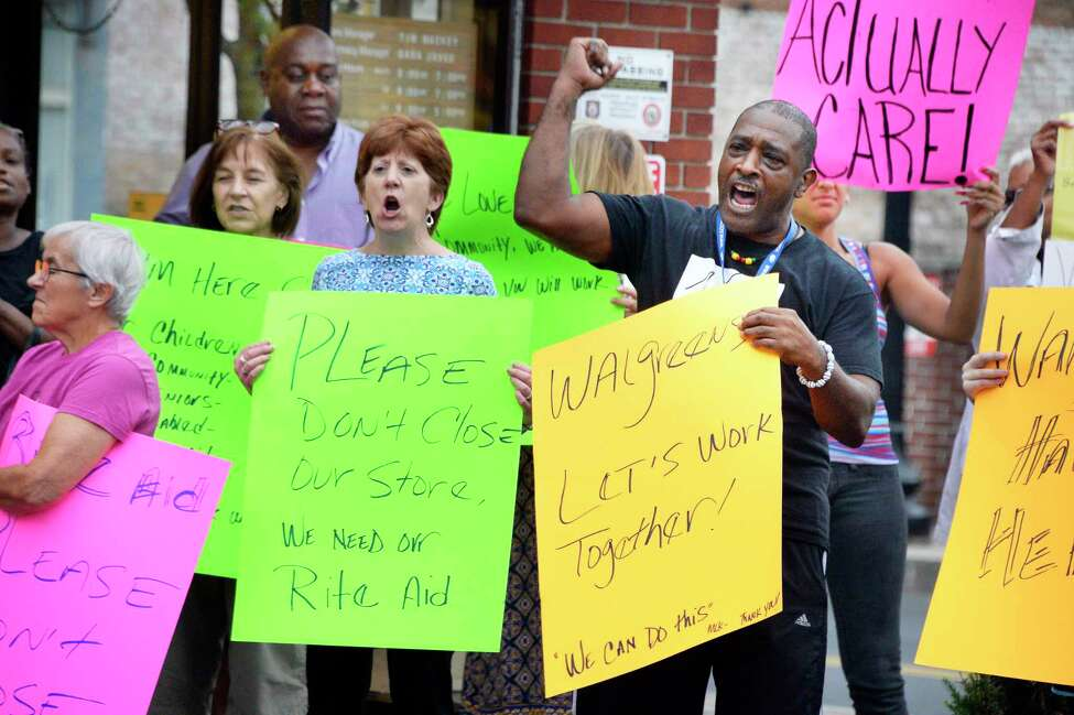 Mayor Kathy Sheehan, center, joins Willie White of AVillage local residents protesting the planned closure of the Rite Aid in the South End of Albany Friday August 31, 2018 in Albany, NY. Rite Aid was recently taken over by Walgreens, and the decision was made following the merger. (John Carl D'Annibale/Times Union)
