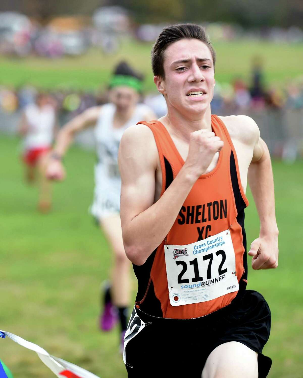 Robert Dillon of Shelton nears the finish line placing third in the 2017 CIAC Fall Championship Boys Cross Country race in Manchester on November 3, 2017.