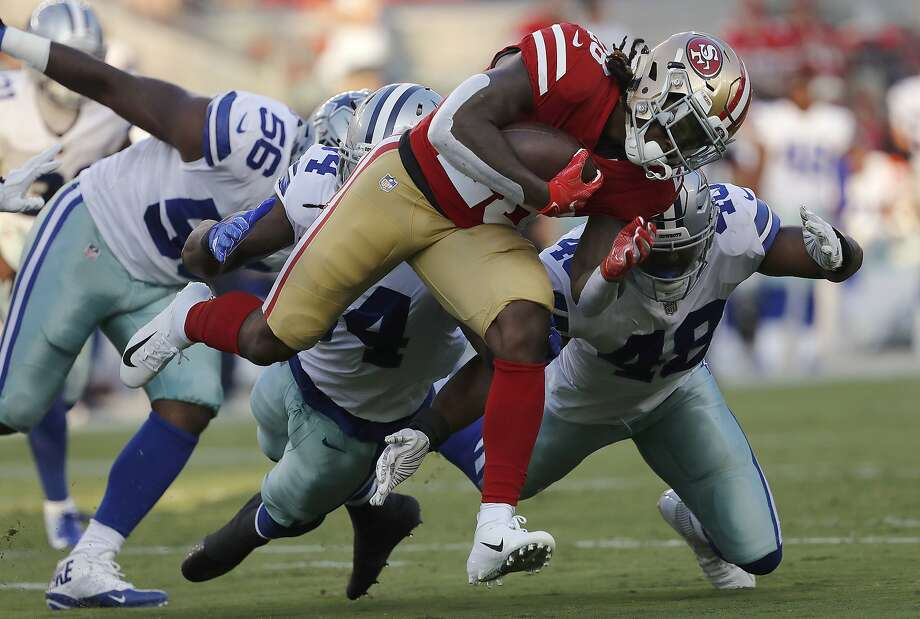 "FILE - In this Aug. 9, 2018, file photo, San Francisco 49ers running back Jerick McKinnon, foreground, carries against Dallas Cowboys defensive end Datone Jones (56), linebacker Jaylon Smith, center left, and linebacker Joe Thomas (48) during the first half of an NFL preseason football game in Santa Clara, Calif. McKinnon has injured his knee in practice and could be facing a serious injury. Coach Kyle Shanahan said Saturday, Sept. 1, 2018, that McKinnon got hurt in his first day of team drills since injuring his right calf Aug. 9. McKinnon will undergo an MRI and Shanahan said the team is ""nervous"" about his outlook.  (AP Photo/Josie Lepe, File) Photo: Josie Lepe / Associated Press"