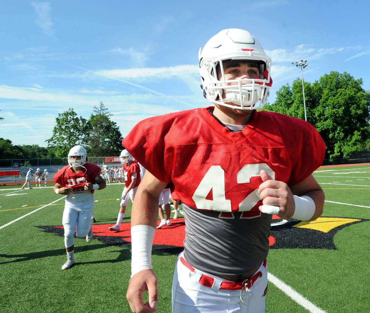 Greenwich's Mozi Bici takes the field for the annual Red vs. White scrimmage at Cardinal Stadium in June.