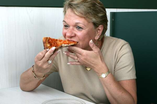 "Reg0531 Photo-Peter Casolino 03/13/06 Fairfield-- Donna Werfelman of Trumbull had never tried Pepe's Pizza until today. She had one comment; ""Delicious."". Photo-Peter Casolino ***SEE STORY"