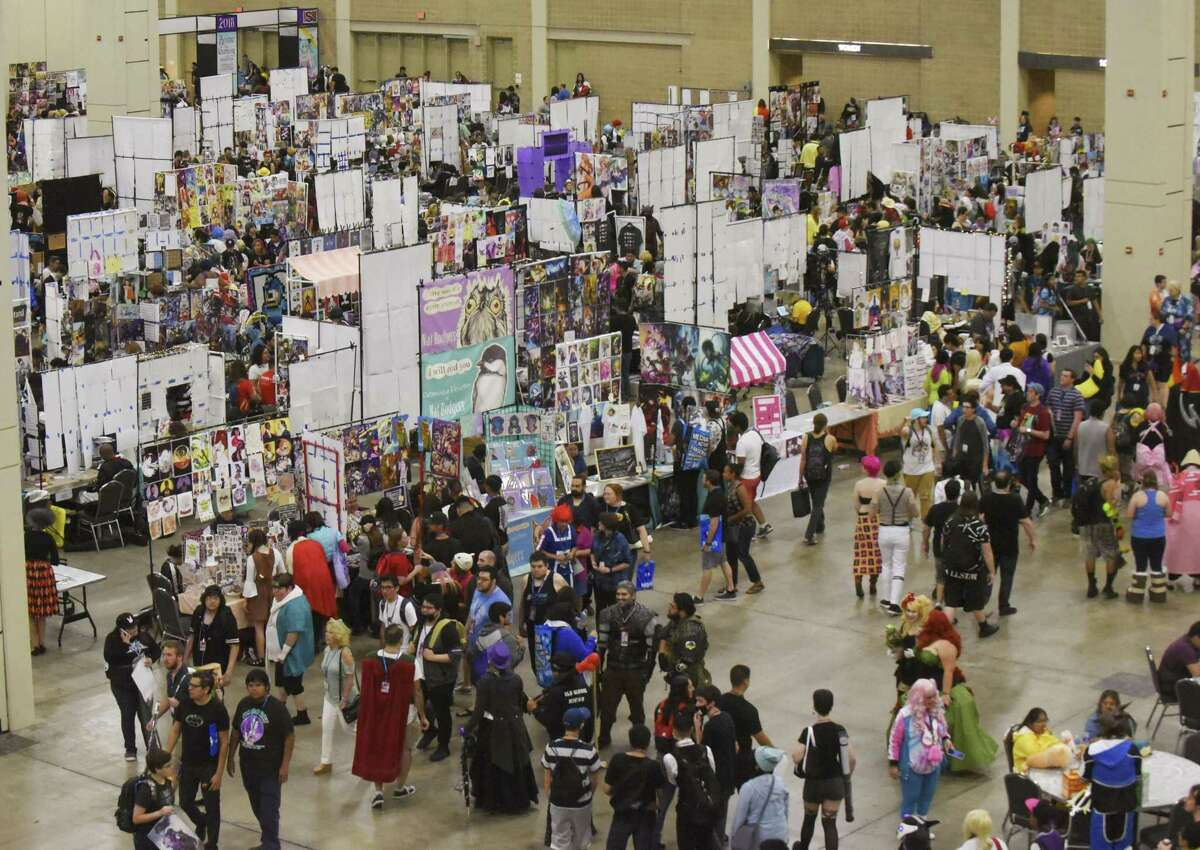 Conventiongoers check out the booths at San Japan on Saturday. The weekend event is the largest celebration of Japanese animation and pop culture in South Texas.