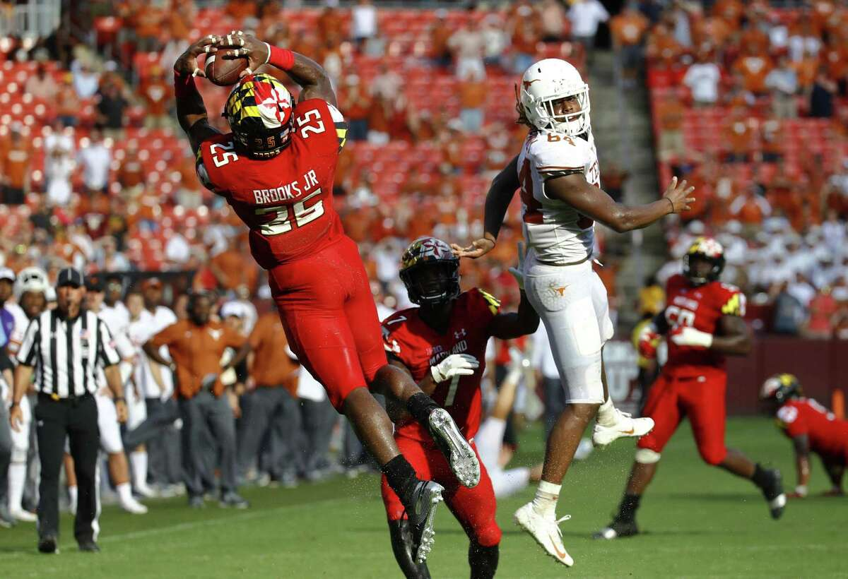 Maryland defensive back Antoine Brooks Jr., left, intercepts a pass attempt intended for Texas wide receiver Lil'Jordan Humphrey, right, in the second half of an NCAA college football game, Saturday, Sept. 1, 2018, in Landover, Md. Maryland won 34-29. (AP Photo/Patrick Semansky)