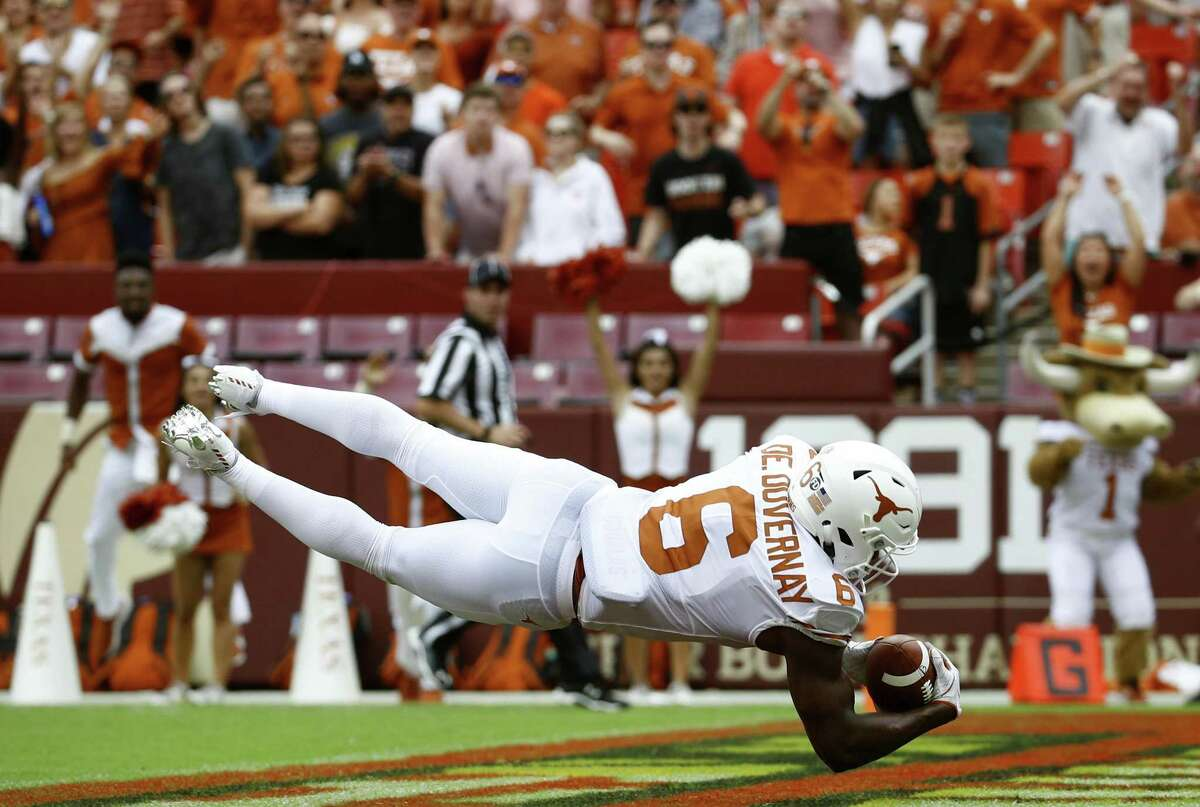 Texas wide receiver Devin Duvernay scores a touchdown in the first half of an NCAA college football game against Maryland, Saturday, Sept. 1, 2018, in Landover, Md. (AP Photo/Patrick Semansky)