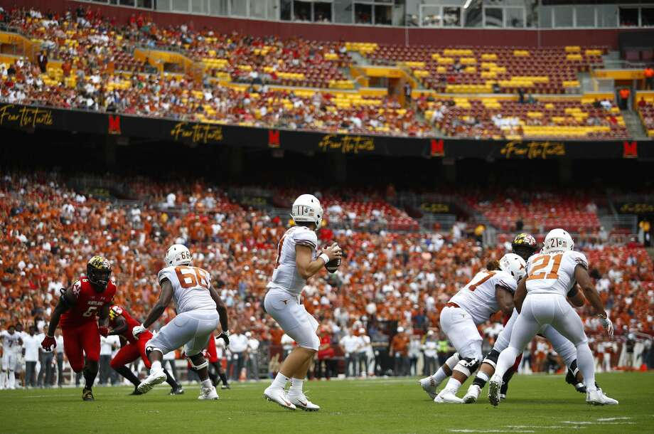 Texas quarterback Sam Ehlinger, center, looks for a receiver in the first half of an NCAA college football game against Maryland, Saturday, Sept. 1, 2018, in Landover, Md. (AP Photo/Patrick Semansky) Photo: Patrick Semansky/Associated Press