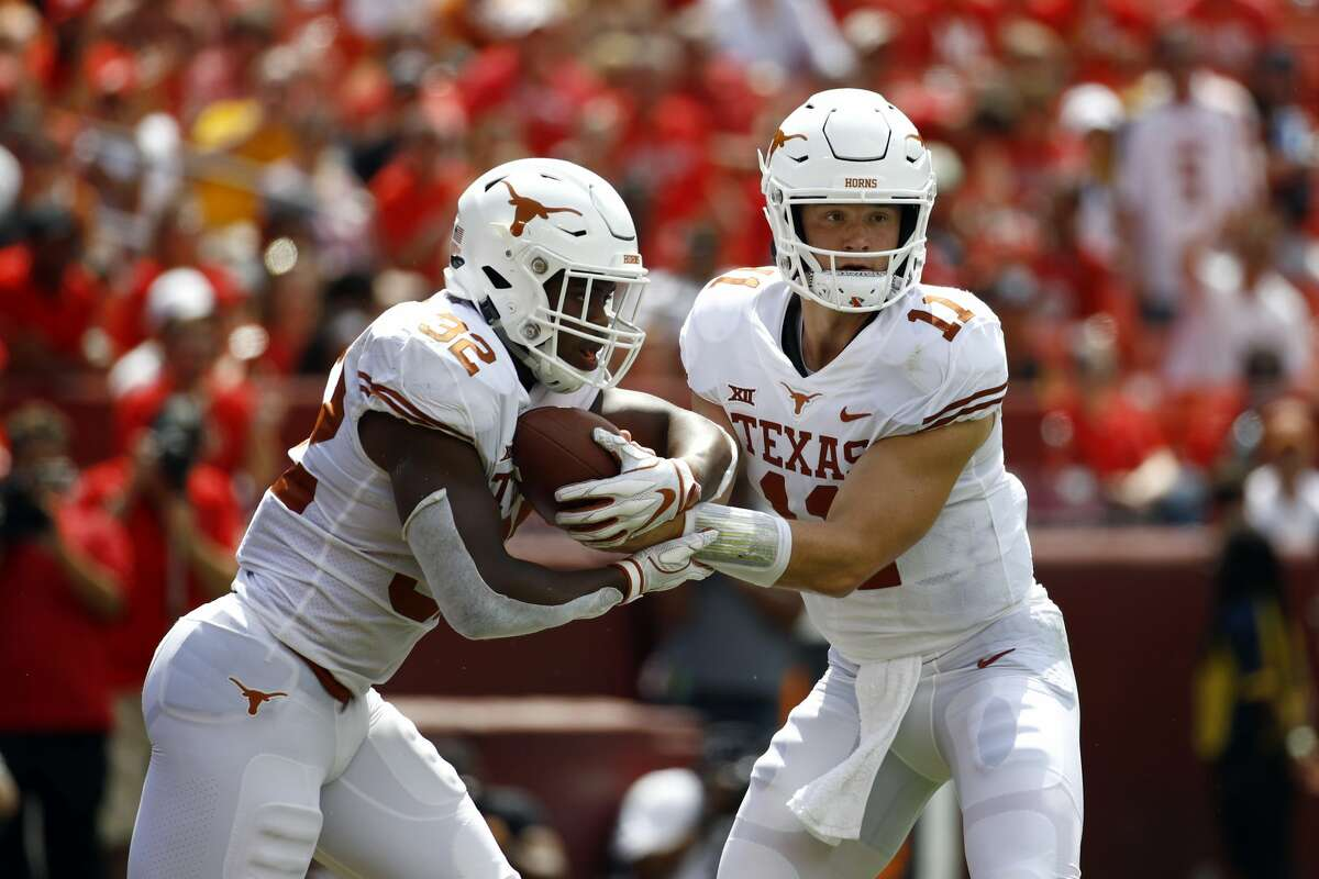 Texas running back Daniel Young, left, takes a hand off from quarterback Sam Ehlinger in the first half of an NCAA college football game against Maryland, Saturday, Sept. 1, 2018, in Landover, Md. (AP Photo/Patrick Semansky)