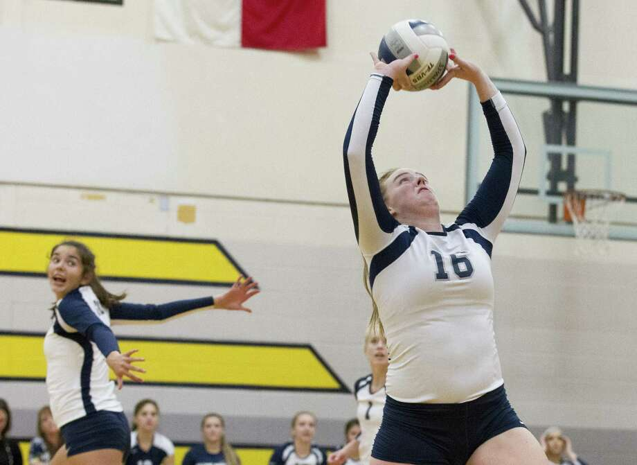 In this file photo, College Park's Annie Cooke (16) sets the ball during the first set of a District 15-6A high school volleyball match at Conroe. Photo: Jason Fochtman, Houston Chronicle / Staff Photographer / © 2018 Houston Chronicle