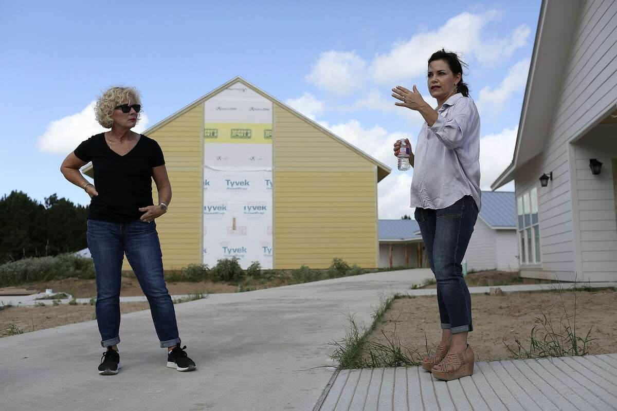 Kim Abernethy, left, president and CEO of ChildSafe, watches as Brooke Crowder, founder and CEO for The Refuge for DMST, leads a tour at The Refuge Ranch near Bastrop on June 14, 2018.