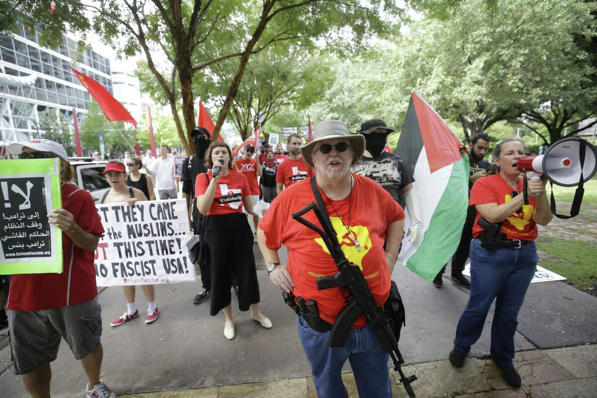 People with the Houston Socialist Movement and other groups counterprotest against the Texas Patriot Network and other white supremacists as they protests outside the Islamic Society of North America Convention at the George R. Brown Convention Center, 1001 Avenida de las Americas, Saturday, Sept. 1, 2018, in Houston.