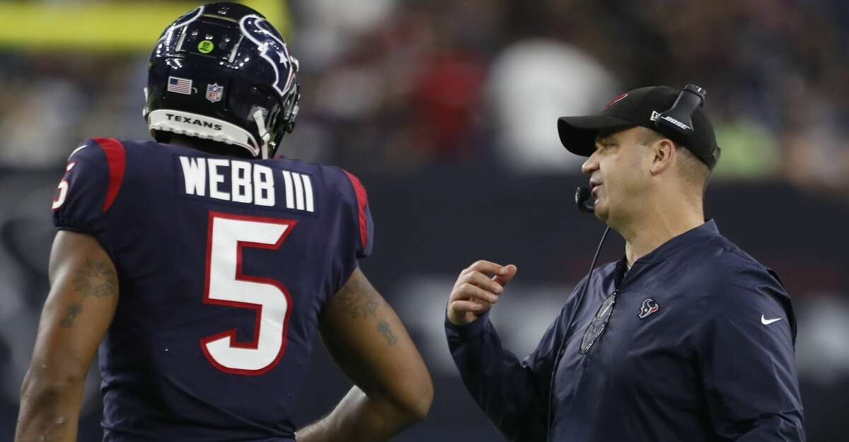 Houston Texans head coach Bill O'Brien talks to quarterback Joe Webb (5) during the fourth quarter of an NFL preseason football game against the Dallas Cowboys at NRG Stadium on Thursday, Aug. 30, 2018, in Houston.