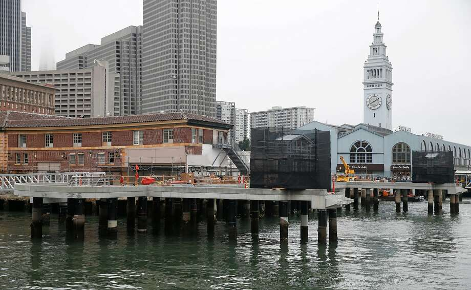 New ferry docks are under construction at the Ferry Building in San Francisco, Calif. on Friday, Aug. 31, 2018. The docks are raised significantly higher than the existing ones to compensate for rising sea levels. Photo: Paul Chinn / The Chronicle 2018