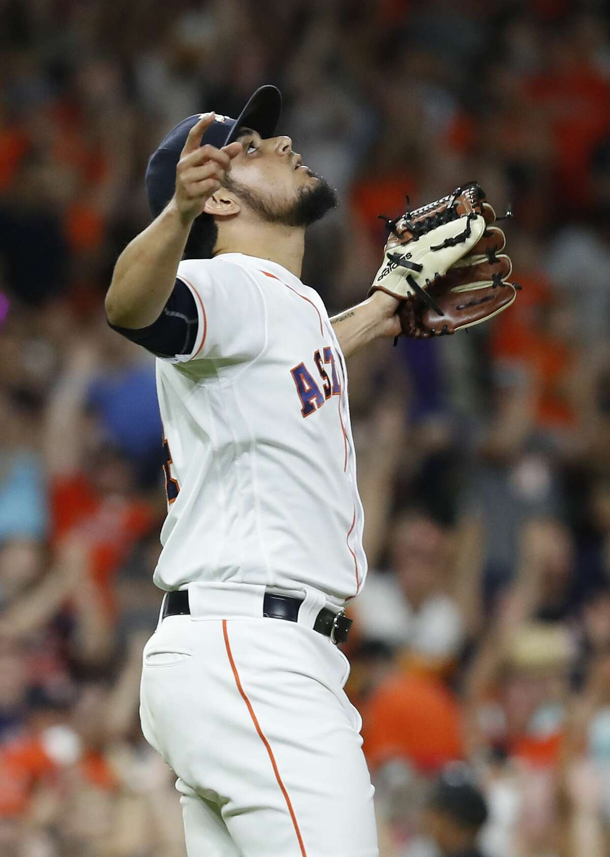 Houston Astros relief pitcher Roberto Osuna (54) reacts after the Astros 7-3 win over Los Angeles Angels during an MLB baseball game at Minute Maid Park, Saturday, September 1, 2018, in Houston.