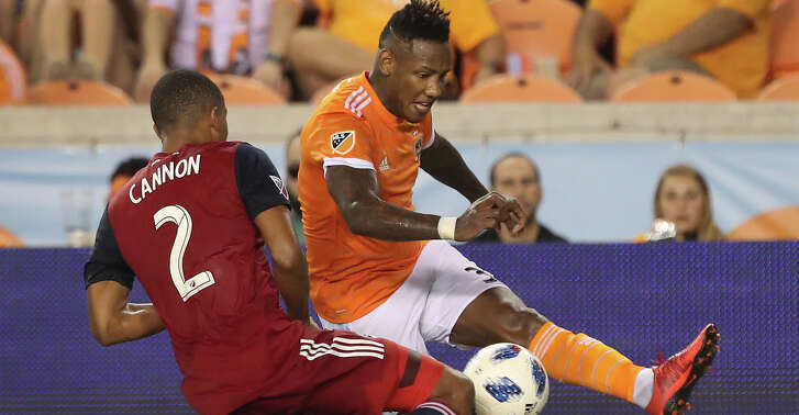 Houston Dynamo forward Romell Quioto (31) kicks the ball around FC Dallas defender Reggie Cannon (2) during a MLS game Thursday, Aug. 23, 2018, in Houston.
