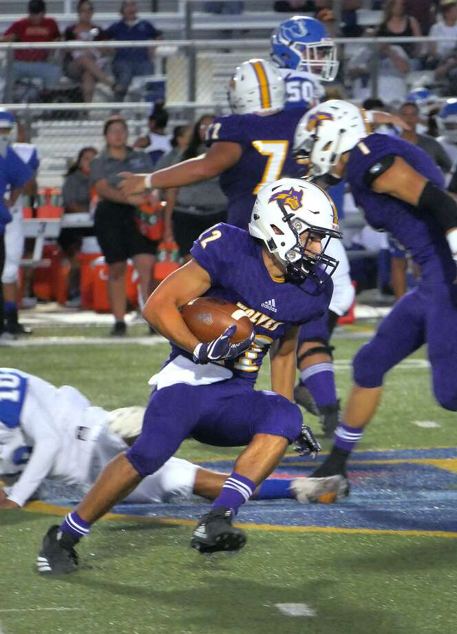 Eddie Santillan ran 10 times for 133 yards and four touchdowns Friday as LBJ fell 45-29 in its season opener against John Jay at the SAC. Photo: Cuate Santos /Laredo Morning Times