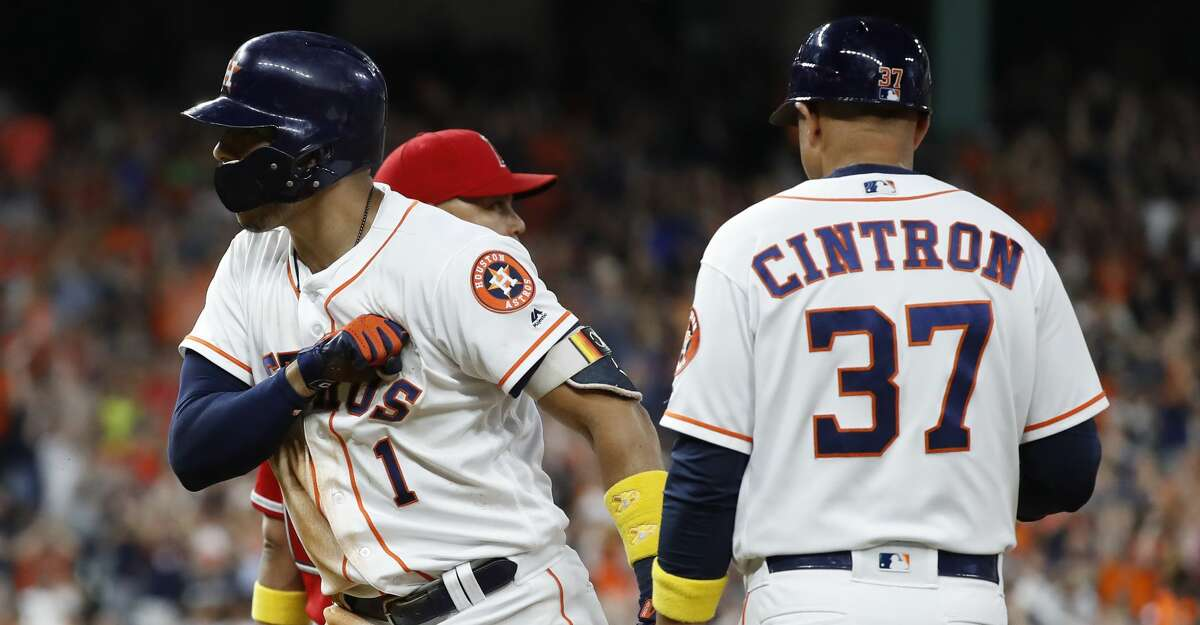 Houston Astros Carlos Correa (1) reacts after his RBI single during the eighth inning of an MLB baseball game at Minute Maid Park, Saturday, September 1, 2018, in Houston.