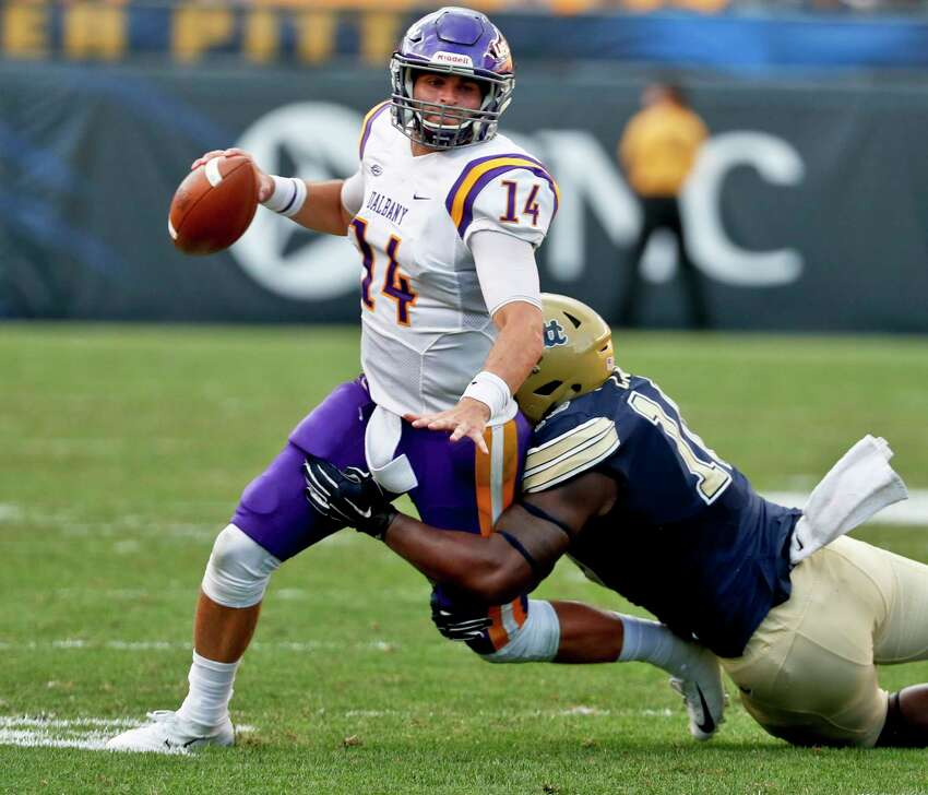 Albany quarterback Vincent Testaverde (17) is sacked by Pittsburgh defensive lineman Keyshon Camp (10) in the second half of an NCAA college football game, Saturday, Sept. 1, 2018, in Pittsburgh. Pittsburgh won 33-7. (AP Photo/Keith Srakocic)