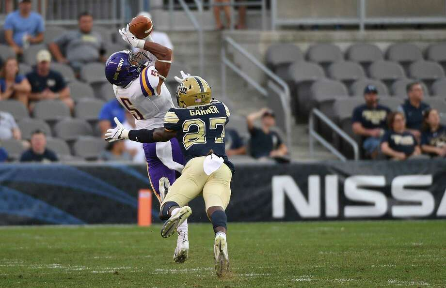 PITTSBURGH, PA - SEPTEMBER 01: Dev Holmes #5 of the Albany Great Danes makes a catch as Bricen Garner #27 of the Pittsburgh Panthers defends in the second half during the game at Heinz Field on September 1, 2018 in Pittsburgh, Pennsylvania. (Photo by Justin Berl/Getty Images) Photo: Justin Berl / 2018 Getty Images