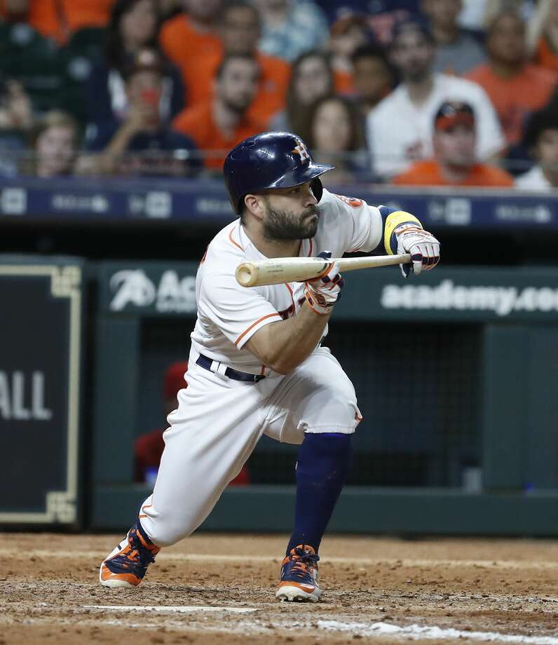 Houston Astros Jose Altuve (27) squares up to bunt during the eighth inning of an MLB baseball game at Minute Maid Park, Saturday, September 1, 2018, in Houston. Photo: Karen Warren/Staff Photographer