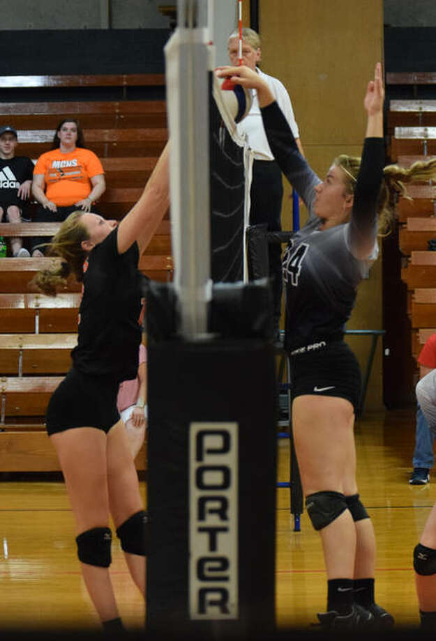 West Central's Alyssa Bartels tips the ball over the net Saturday at Meredosia. The Cougars came in second in the tournament. Photo: Audrey Clayton | Journal-Courier