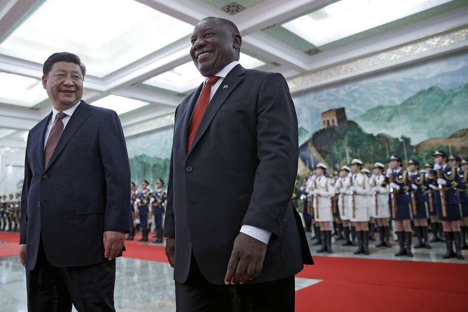 Chinese President Xi Jinping welcomes South African President Cyril Ramaphosa with an honor guard in Beijing. Photo: Andy Wong / Associated Press