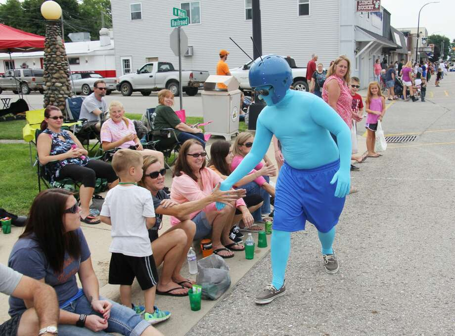 Little Blue Man — an iconic, mysterious figure — returned to where he was first spotted in 1958: Elkton. However, his appearance this time wasn't in the dark, but rather during the town's annual AutumnFest Grade Parade. Photo: Bradley Massman