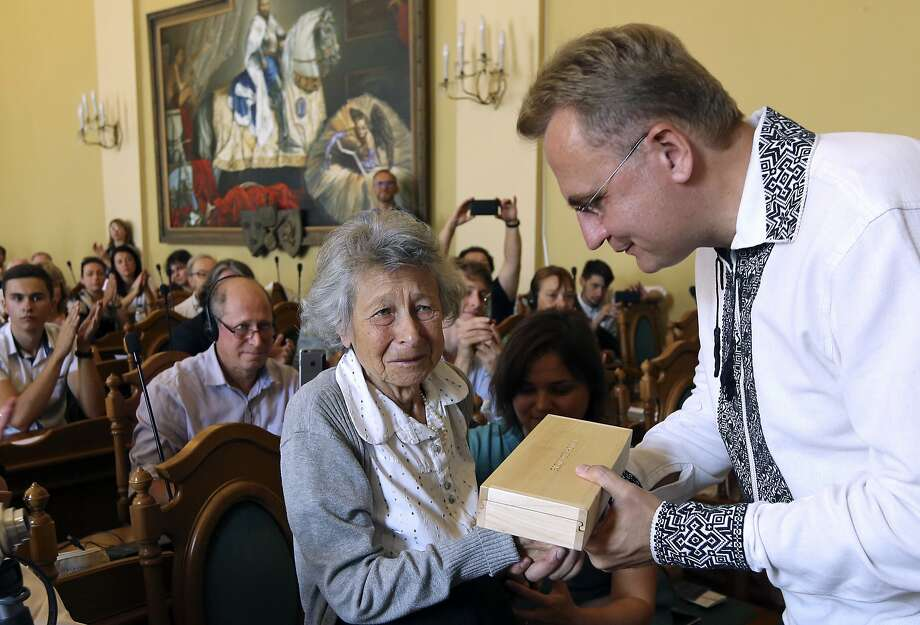 Yanina Hescheles, a Polish writer and a Nazi concentration camp survivor, receives a copy of a synagogue key from Lviv Mayor Andriy Sadovyi. The city was once a hub of Jewish life. Photo: Yevheniy Kravs / Associated Press