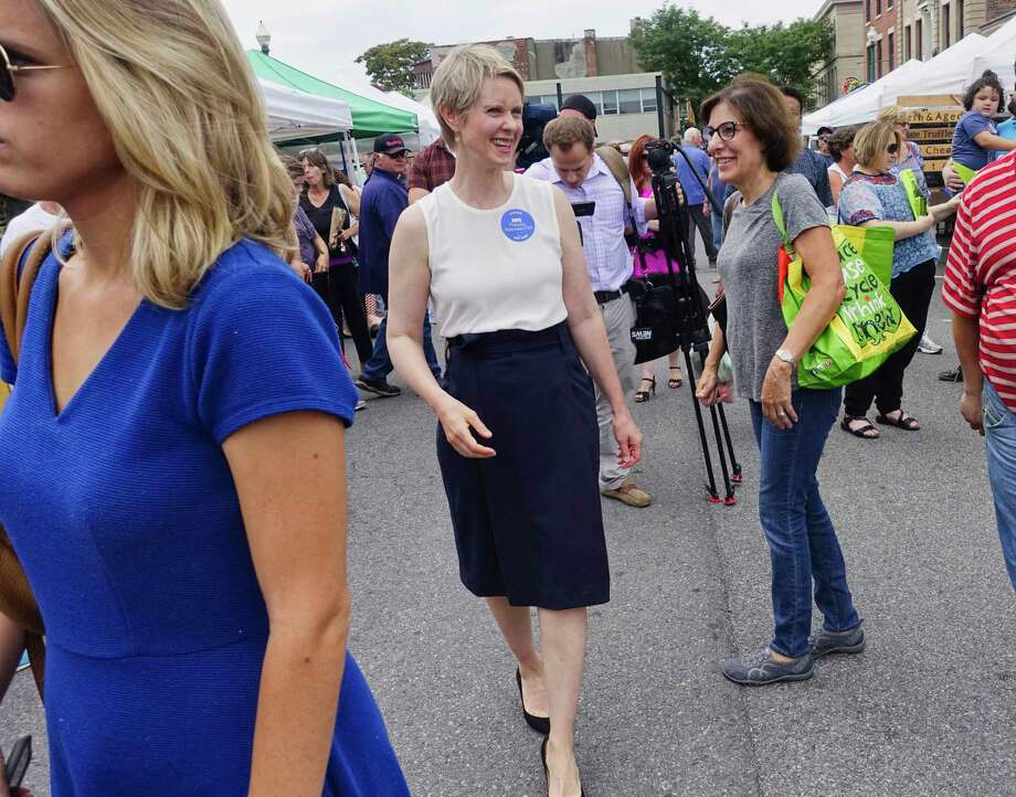Candidate for governor, Cynthia Nixon, left, makes her way through the farmer's market before taking part in a rally on the steps of Schenectady City Hall on Sunday, Sept. 2, 2018, in Schenectady, N.Y.   (Paul Buckowski/Times Union) Photo: Paul Buckowski, Albany Times Union / (Paul Buckowski/Times Union)