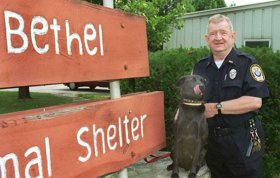 File photo of Edward Robinson with a pup at the Bethel Animal Shelter. Photo: Michael Duffy /