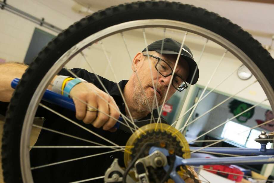 Robert Cowling, of Bay City/Saginaw, works on a bike for the Recycle-A-Bike program, hosted by Tri-City Cyclists, on Saturday, Sept. 1, 2018 at the old Windover School at 32 S. Homer Road in Midland. (Mackenzie Brockman/for the Daily News) Photo: (Mackenzie Brockman/for The Daily News)