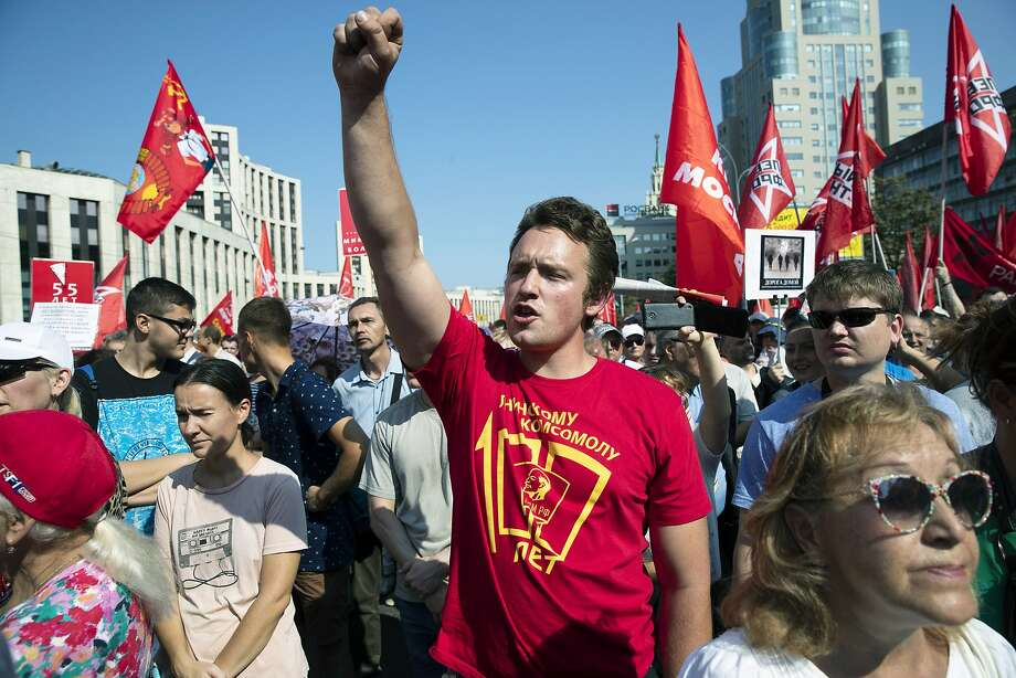 A demonstrator joins a rally in Moscow protesting proposed increases in the retirement age. Photo: Pavel Golovkin / Associated Press