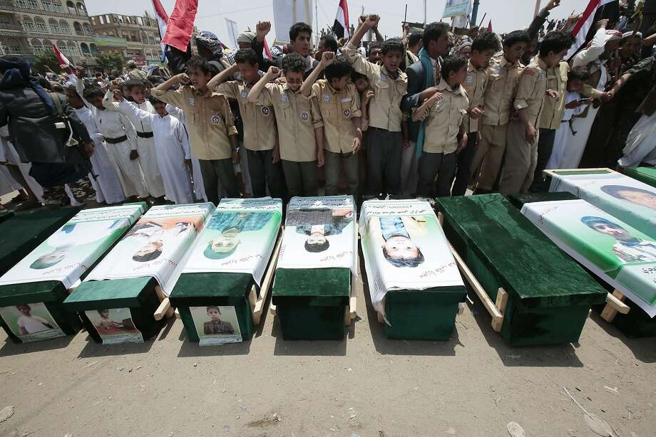"""Yemenis attend the funeral Aug. 13 of victims of a Saudi-led air strike near Saada that killed 51 people, including 40 children. Human Rights Watch labeled the strike an """"apparent war crime."""" Photo: Hani Mohammed / Associated Press"""